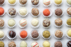 Truffle chocolates in rows Stock Photography