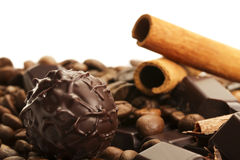Truffle in front of coffee, cinnamon and chocolate Stock Photo