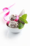 Truffles. In a bowl with a bow isolated on white background stock photo