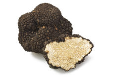 Truffles. Freshly harvested truffles and sliced close up royalty free stock image