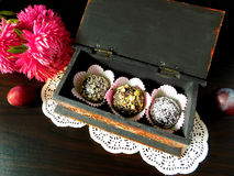 Truffles in a box. Set of truffle sweets with assorted sprinkles in a present box stock images