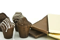 Truffles and chocolate bars Royalty Free Stock Photography