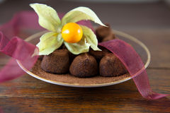 Truffles with cocoa and physalis Royalty Free Stock Photography