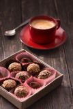 Truffles and coffee cup Royalty Free Stock Photos