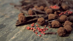 Truffles in dark chocolate with red pepper and chocolate chips. Close up rotation shot of Composition with truffles in cocoa dust with red pepper and chocolate stock video footage