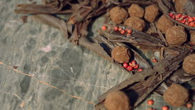 Truffles in dark chocolate with red pepper and chocolate chips. Close up sliding shot of Composition with truffles in cocoa dust with red pepper and chocolate stock footage