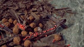 Truffles in dark chocolate with red pepper and chocolate chips. Close up sliding shot of Composition with truffles in cocoa dust with red pepper and chocolate stock video footage