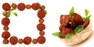 Truffles, hazelnuts and mint leaf Royalty Free Stock Photo