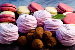 Truffles, marshmallows and macaron Stock Photos