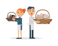 Truffles sellers with mushrooms in wicker baskets Royalty Free Stock Photos