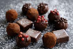 Truffles on sugary background. Truffles on sugary black background Royalty Free Stock Photography