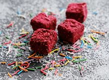 Truffles on sugary background. Raspberries truffles on sugary background Royalty Free Stock Images