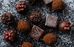 Truffles on sugary background. Truffles on sugary black background Royalty Free Stock Photos
