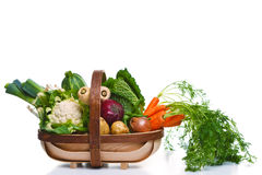 Trug full of organic vegetables isolated on white Royalty Free Stock Photo