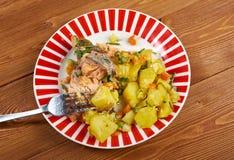 Truite cuite au four avec des pommes de terre Photographie stock