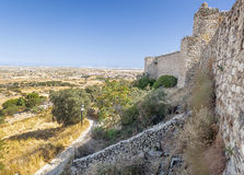 Trujillo castle. Field, located around the castle of the Spanish town of Trujillo, are walls of its towers is Arabic style. Its a sunny day Royalty Free Stock Photos