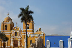 Trujillo Cathedral. Bright yellow colonial style Cathedral in the Plaza de Armas in Trujillo, Peru. Adjacent blue building is the Bishops Palace Royalty Free Stock Photos