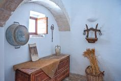 The trulli of Alberobello. Alberobello, Italy - July 19, 2006: The interior of the  Trulli, rural dwellings of medieval origin made with dry stones Royalty Free Stock Image