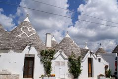 The trulli of alberobello. The trullo is a type of conical construction in traditional dry stone in central-southern Puglia. Trulli were generally built as Stock Photos