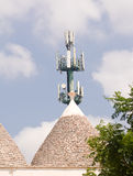 Trulli and antenna: technology and tradition in ugly contrast stock image