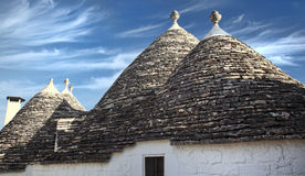 Trulli and blue sky Stock Images
