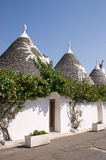 Trulli houses in Alberobello (Apulia). Exterior of traditional trulli houses in Alberobello (Puglia, Italy). These dry-stone houses with conical roofs are Stock Images