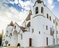 The Trulli houses of Alberobello in Apulia in Italy. The Trulli of Alberobello in Apulia in Italy. These typical houses with dry stone walls and conical roofs stock photo