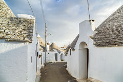 The Trulli houses of Alberobello in Apulia in Italy. The Trulli of Alberobello in Apulia in Italy. These typical houses with dry stone walls and conical roofs stock image
