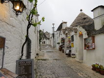 Trulli houses. Image of of trulli houses with church in the background taken in Alberobello. Apulia Royalty Free Stock Photos
