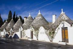 Trulli and magical symbols. Alberobello. Trulli and magical symbols on the roofs Royalty Free Stock Image
