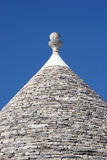 Trulli roof on blue sky. Mediterranean - Italian typical  historical building: Trulli (roof particular Stock Photography