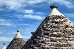 Trulli roof and blue sky Stock Image