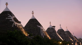 Trulli at sunset in Alberobello (Italy) Royalty Free Stock Images