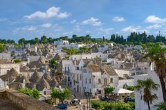 Trulli town of Alberobello in Puglia, Italy. Alberobello, Italy - 11 May, 2014: a panoramic view on a beautiful particular extraordinary town in Puglia Royalty Free Stock Photography