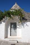 Trullo drzwi z Gronowym winogradem Fotografia Stock