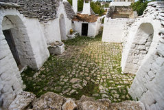 Trullo's Courtyard. Courtyard of a trullo, ancient stone contructions of pre-historic origin of the Bronze Age, Alberobello, Apulia, Italy Stock Image