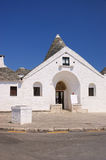 Trullo Sovrano. In Alberobello (Apulia, Italy). This is the only trulli house with two floors built in Alberobello Royalty Free Stock Photo