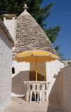 Trullo with Table and Chairs Royalty Free Stock Photography