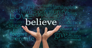 Truly Believe. Female hands reaching up into the night sky with the word 'believe' floating above, surrounded by a word cloud of wise words stock illustration