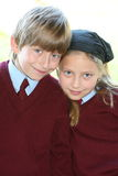 They truly love school. Brother and sister are going to irish school this morning in uniforms Stock Photos