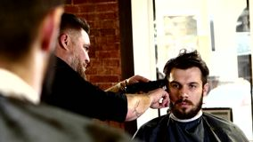 Truly stylish men's hairdresser: Master in tattoos stock video