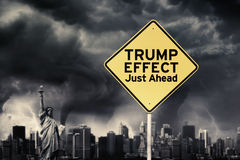 Trump Effect word under dark cloud. Picture of word of Trump Effect Just Ahead on a yellow signpost under dark cloud Stock Image