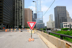 Trump International Hotel and Tower. CHICAGO, IL - MAY 25: The Trump International Hotel and Tower with Yield sign in front,  May 25 2016 in Chicago, Illinois Royalty Free Stock Photography