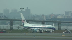 Trump Pence press plane before takeoff. New York, USA - October 6, 2016: Jet airplane carrying journalists for the Donald Trump presidential campaign awaits stock video footage