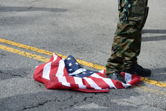 Trump Protester Desecrates Flag Stock Images