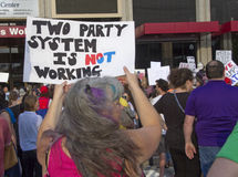 Trump Protester Holds Sign Saying Two Party System Is Not Workin Stock Images