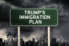 Trump`s Immigration Plan word under storm cloud. Text of Trump`s Immigration plan on a green signpost in the storm cloud background royalty free stock image