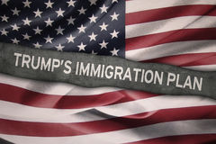 Trump`s Immigration Plan word with USA flag Stock Image
