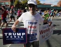 Trump supporter with political signs runs at New York City Marathon. NEW YORK - NOVEMBER 6, 2016: Trump supporter with political signs runs at New York City Stock Photography