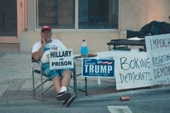 Trump supporter sitting outside with signs and posters. First Democratic Debates 2019 Second Round. Against Joe Biden, Bernie Sand stock photography
